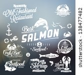 Collection of vintage retro grunge seafood restaurant labels, badges and icons typography