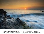 large rocks on the beach  and... | Shutterstock . vector #1384925012