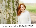 thoughtful young redhead woman... | Shutterstock . vector #1384962035