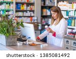 Female pharmacist working in...