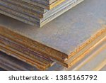 sheet metal is in bundles in... | Shutterstock . vector #1385165792