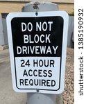 do not block driveway  24 hour... | Shutterstock . vector #1385190932