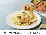 homecooked garlic shrimp scampi ... | Shutterstock . vector #1385266592