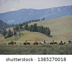 Small photo of Wyoming, USA--July 2018: Horseback riders plod along the road at Cooke Pass, Yellowstone National Park.