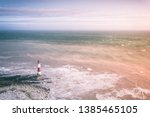lighthouse at idyllic coastline ... | Shutterstock . vector #1385465105