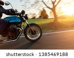 motorcycle driver riding in... | Shutterstock . vector #1385469188