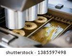 mini donut machine. automatic... | Shutterstock . vector #1385597498