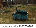 blue old disassembled car near...   Shutterstock . vector #1385736782