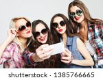 four happy teenage girls with... | Shutterstock . vector #1385766665
