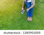 woman using mobile smart phone...   Shutterstock . vector #1385901005