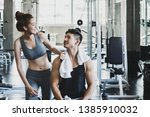 couple fitness man and asian... | Shutterstock . vector #1385910032