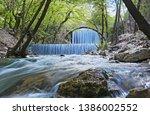 double waterfalls of... | Shutterstock . vector #1386002552