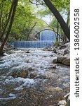 double waterfalls of... | Shutterstock . vector #1386002558