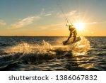 Kitesurfer Doing Tricks In...