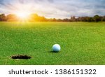 white golf ball on green course ... | Shutterstock . vector #1386151322