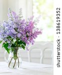 Bunch Lilac In Vase On Table