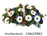 White flowers and dark green leaves in a basket, white gerbera. Flowers Arrangement of white, red and blue flowers. - stock photo