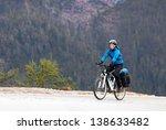 girl cyclist among the high... | Shutterstock . vector #138633482