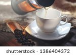 brewed tea on a serving table... | Shutterstock . vector #1386404372