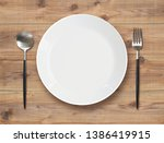 white dish spoon and fork on...   Shutterstock . vector #1386419915