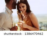 close up of a smiling couple... | Shutterstock . vector #1386470462