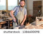 bearded joiner in safety... | Shutterstock . vector #1386600098