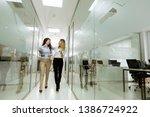 two young businesswomen... | Shutterstock . vector #1386724922