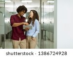 young multiethnic business... | Shutterstock . vector #1386724928