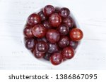 grapes red fruits fruit from... | Shutterstock . vector #1386867095
