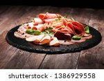 food tray with delicious salami ... | Shutterstock . vector #1386929558