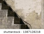 Small photo of Grungy, cement staircase with blank wall