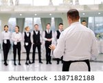 briefing at the restaurant. the ... | Shutterstock . vector #1387182188