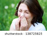 Young Woman Sneezing In A...