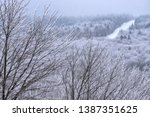 iced trees  winter view along... | Shutterstock . vector #1387351625