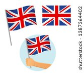 united kingdom flag in hand.... | Shutterstock .eps vector #1387364402