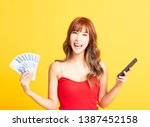happy asian woman holding... | Shutterstock . vector #1387452158