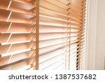 wooden shutters blind on the... | Shutterstock . vector #1387537682