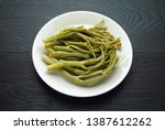 pickled kali tragus on a plate. ...   Shutterstock . vector #1387612262