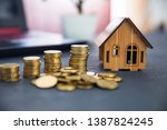 coins with house model and... | Shutterstock . vector #1387824245