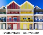 street with colorful houses in... | Shutterstock . vector #1387903385