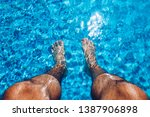 relaxing at the swimming pool....   Shutterstock . vector #1387906898