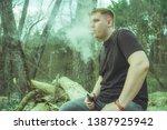 overweight man smoking near... | Shutterstock . vector #1387925942