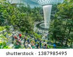 Small photo of Singapore / Singapore - April 17 2019 : Jewel Changi Airport Rain Vortex. This is the largest indoor waterfall in the world and the centerpiece of Jewel Changi Airport.