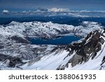 Mount St. Helens crater and Spirit lake with mount Rainier in the distance. Snow covered mountains view from Saint Helens crater rim. Seattle. Washington. United States of America