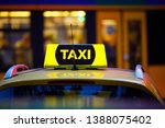 taxi detail and blurred yellow... | Shutterstock . vector #1388075402