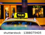 taxi detail and blurred yellow... | Shutterstock . vector #1388075405