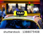 taxi detail and blurred yellow... | Shutterstock . vector #1388075408