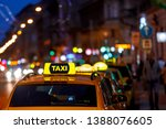 taxi and blurred city lights at ... | Shutterstock . vector #1388076605