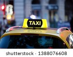 taxi and blurred city lights at ... | Shutterstock . vector #1388076608