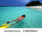 young lady snorkeling in a... | Shutterstock . vector #138808862